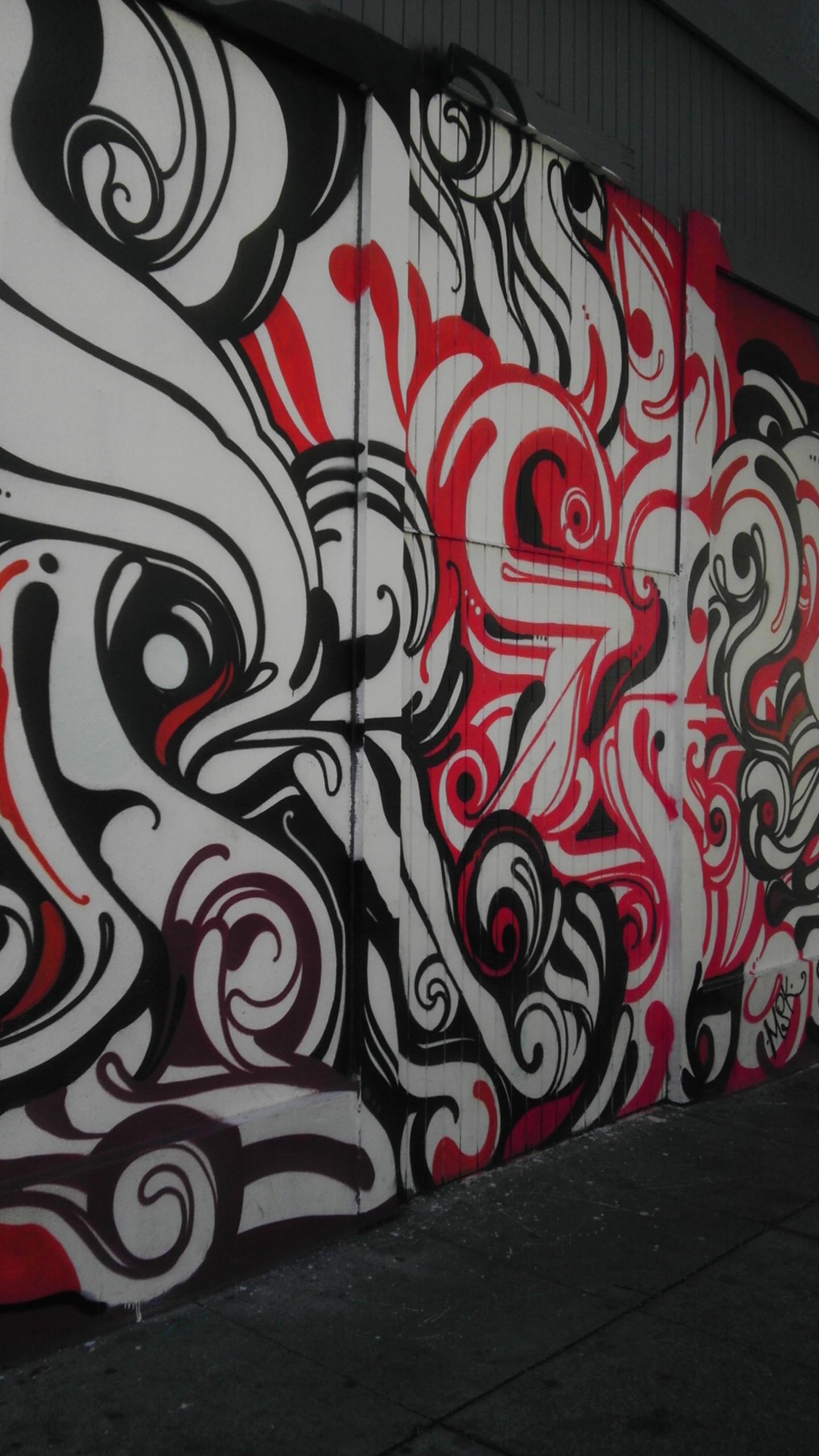 black red swirl San Francisco mural