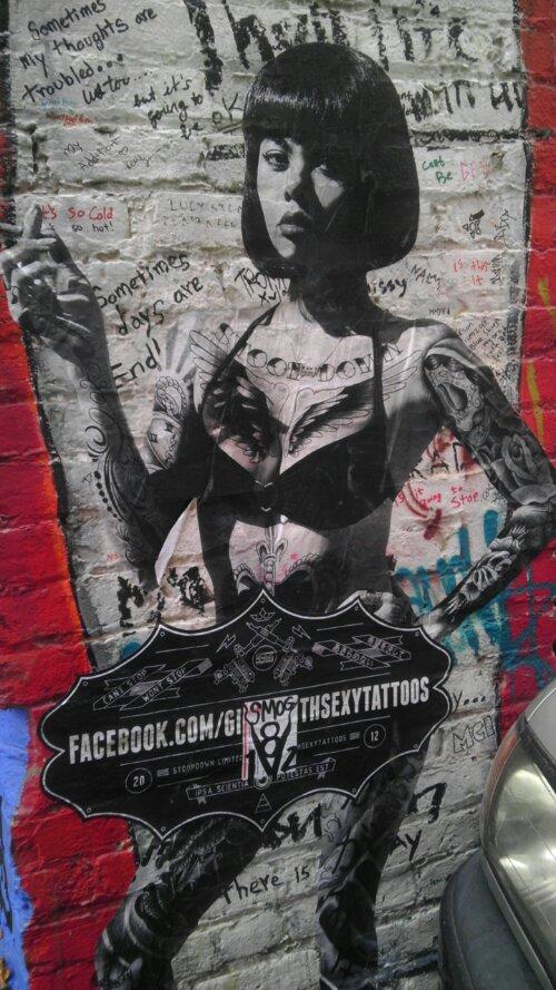 sexy tattoo lady clarion alley graffiti