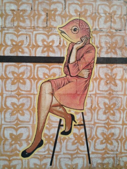fish person street art Tulum